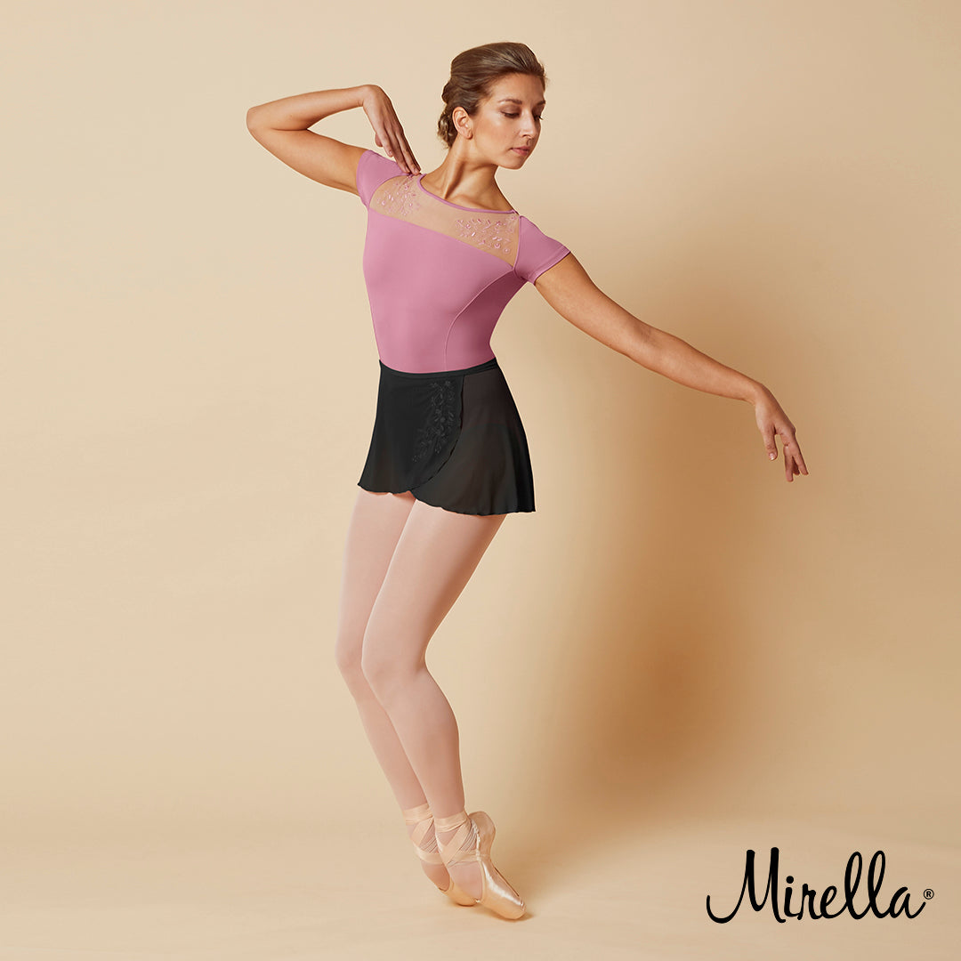 Ballet dancer Sasha Mukhamedov dancing wearing the Mirella Jasmine wrap skirt with embroidery with the wide neck open back leotard in Dusty Rose
