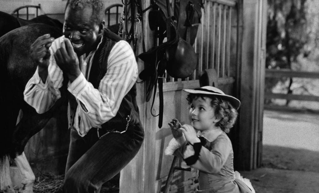 Shirley Temple as a child tap dancing with Bill 'Bojangles' Robinson