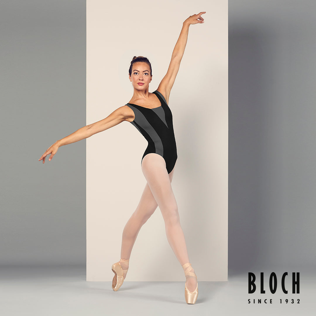 Ballet dancer Tierney Heap dancing in the studio wearing the Esrah tank leotard in black, pink tights and pointe shoes