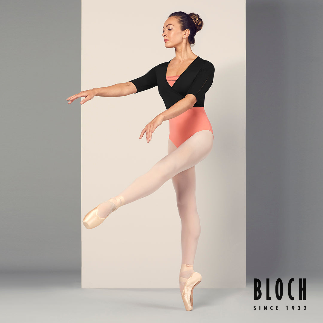 Ballet dancer Tierney Heap dancing en pointe in the Meline ladder trim wrap top, pink tights and pointe shoes