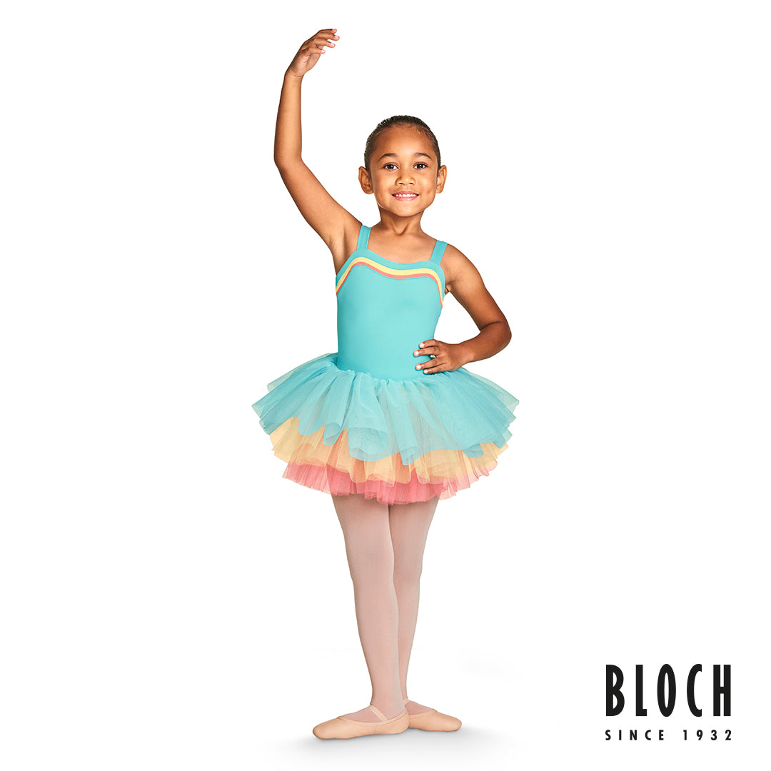 A young ballet dancer dancing wearing the Teagan wide strap leotard with Lenora contrast tutu skirt from the BLOCH Gelato spring collection