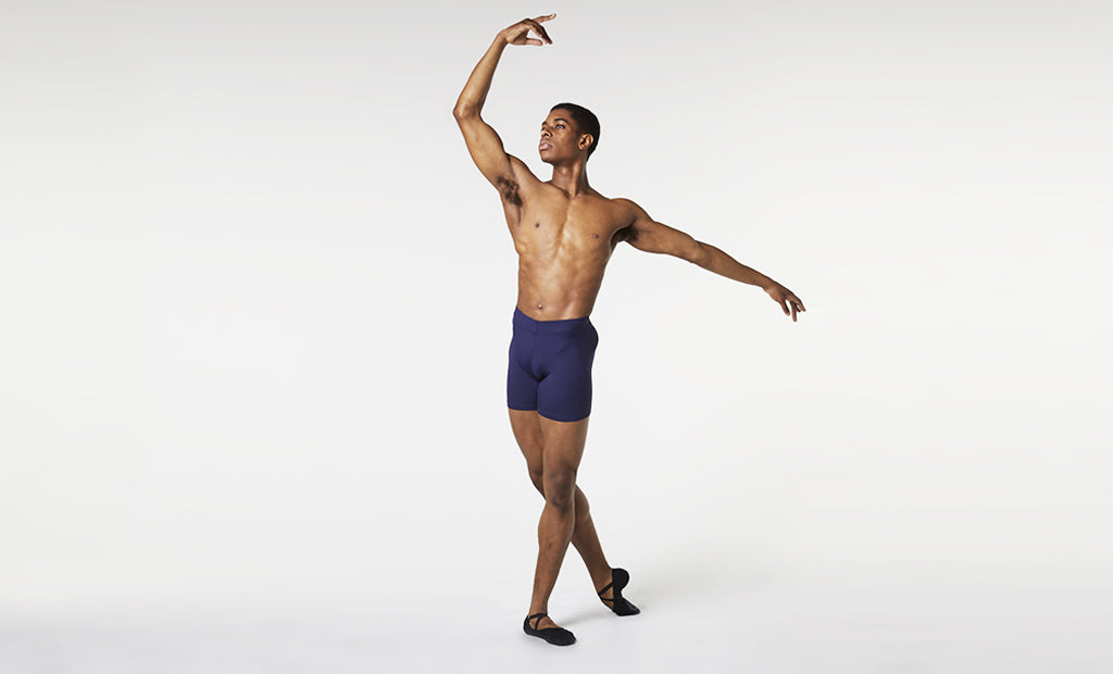 A male dancer practising his routine wearing BLOCH short length rehearsal tight