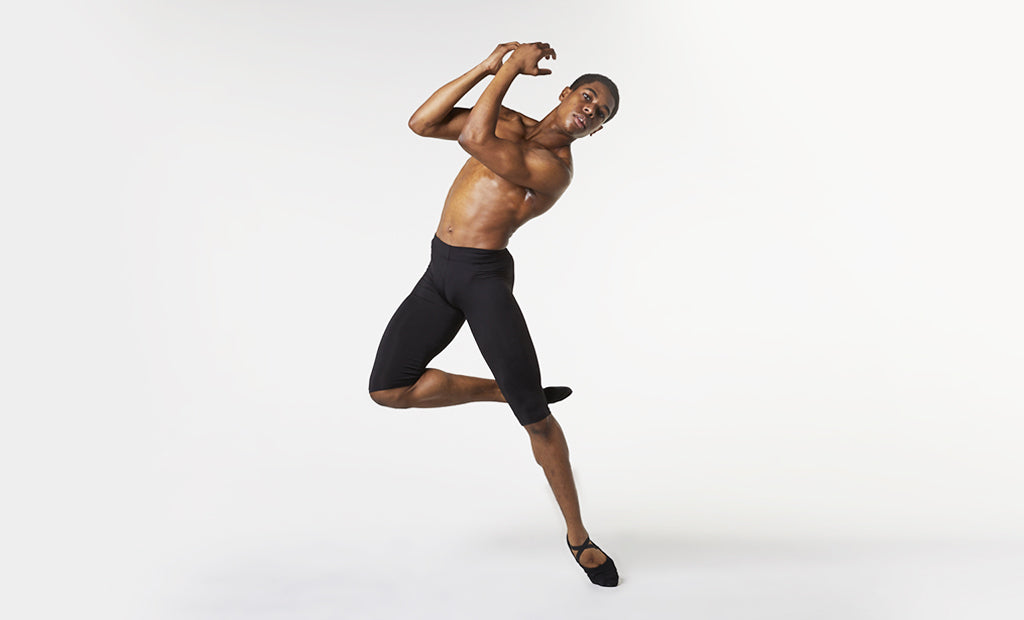 A male dancer practising his routine wearing BLOCH ballet shoes and mid length rehearsal tights