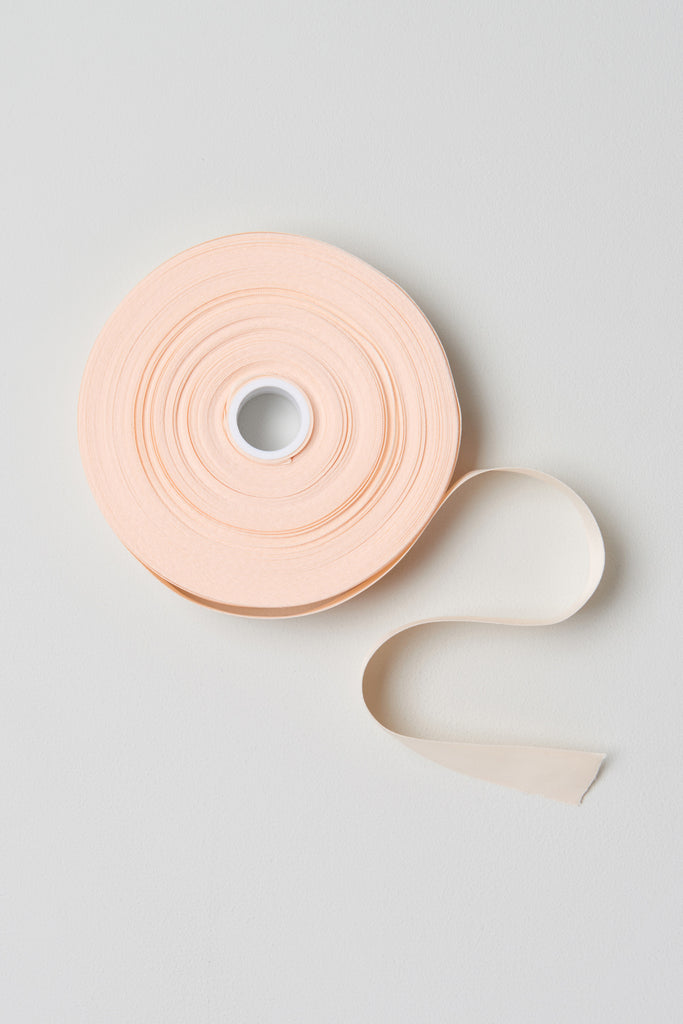 Pink satin Bloch Soft Satin Ribbon Roll flatlay roll of ribbon