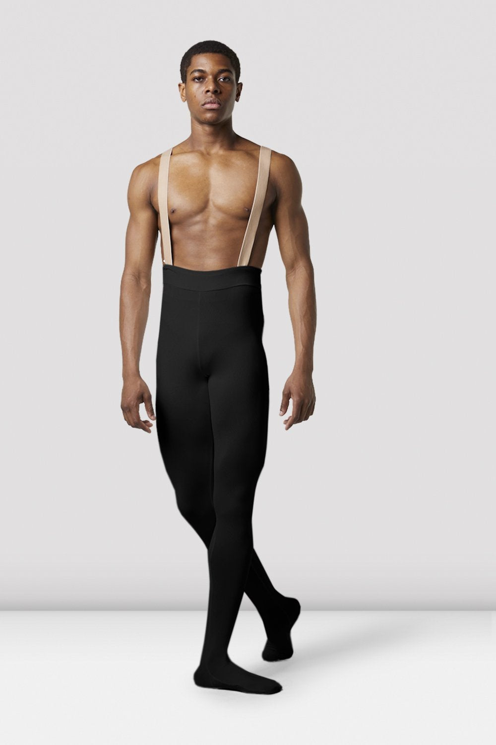Black Bloch Mens Performance Footed Dance Tight on male model parallel feet with right foot en pointe with arms by side facing back