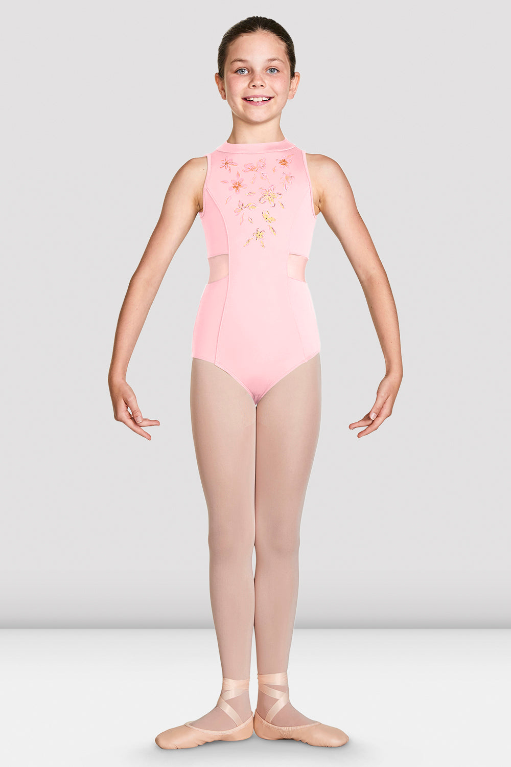 Candy Pink Bloch Girls Adrika High Neckline Zip Back Tank Leotard on female model in first position with arms in demi bras