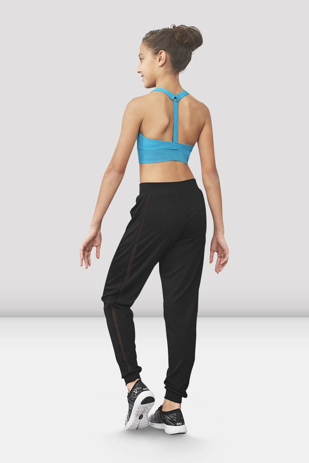 Black Bloch Girls Tilly Drawstring Waist Loose Pant on female model left level beveled facing upstage right