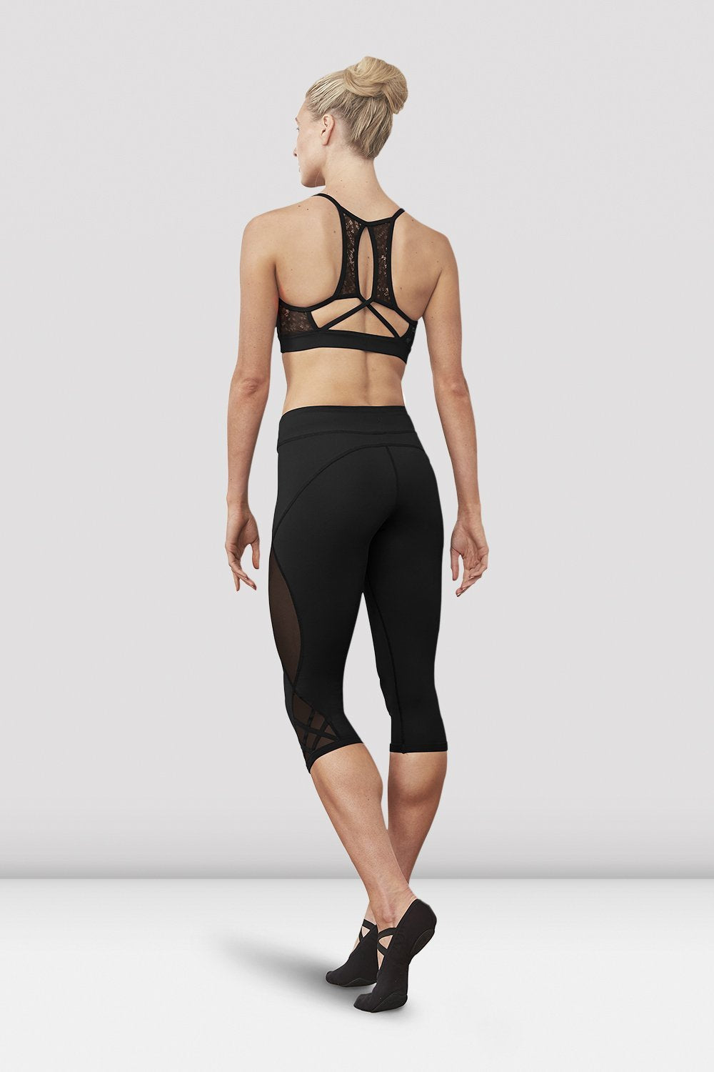 Black Bloch Ladies Kalise Capri Legging on female model left level beveled facing upstage right