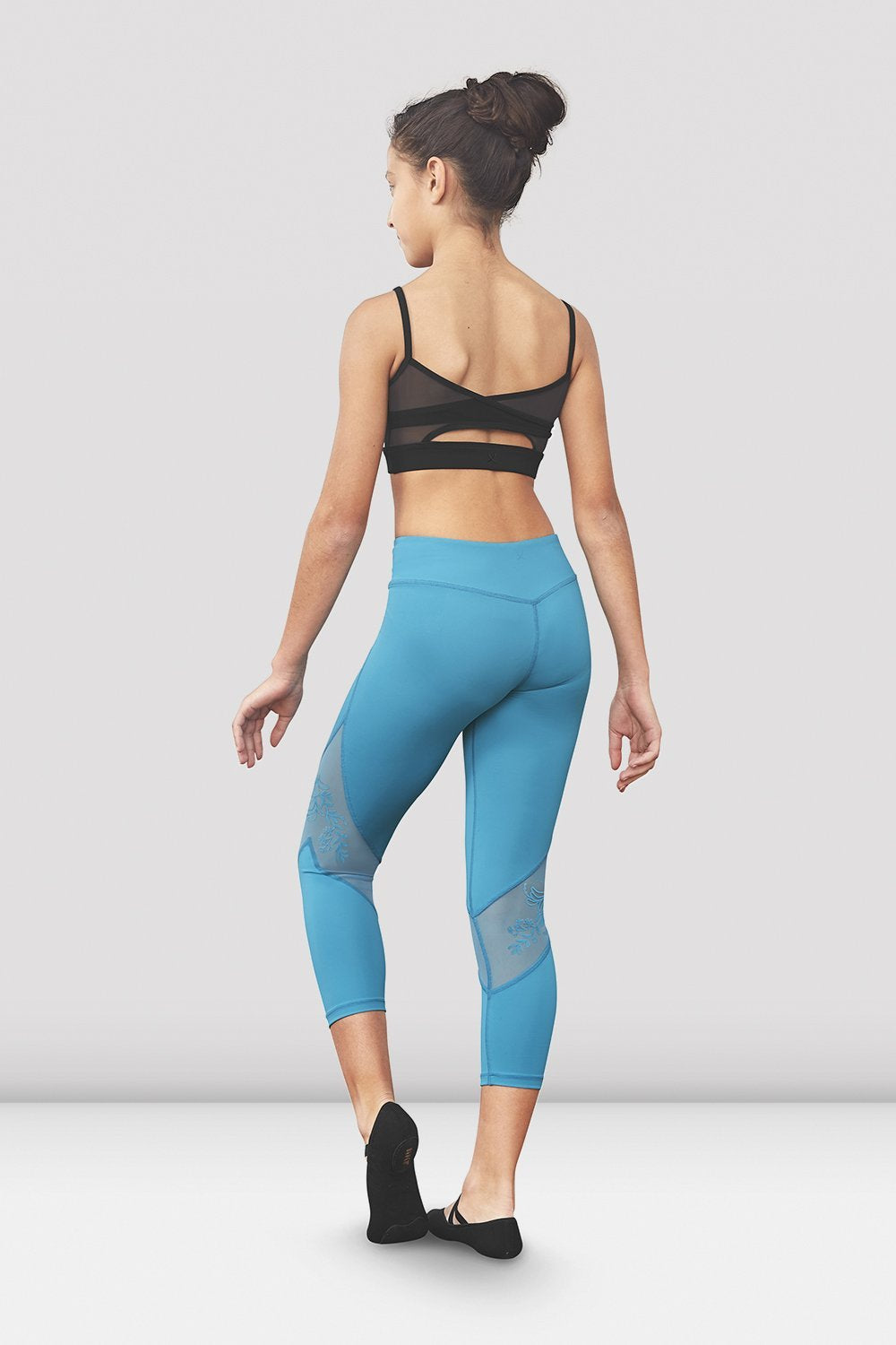 Turquoise Bloch Girls Jessy Mesh Panel Seven Eights Legging on female model left level beveled facing upstage right