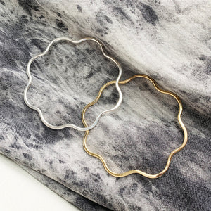 Bloom Bangles in brass and sterling silver