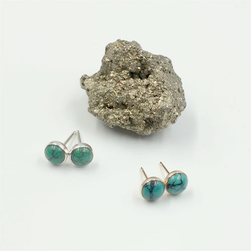 Tiny turquoise stud earrings by Knucklekiss