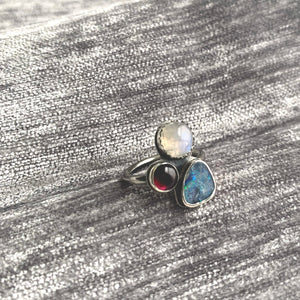 Australian opal, rainbow moonstone and garnet multi stone cluster ring by Knuckle Kiss