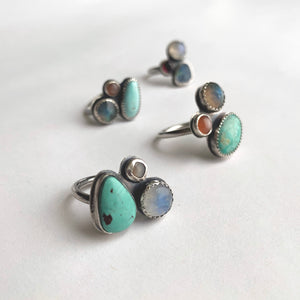 Multi-gemstone cluster rings by Knuckle Kiss Jewelry