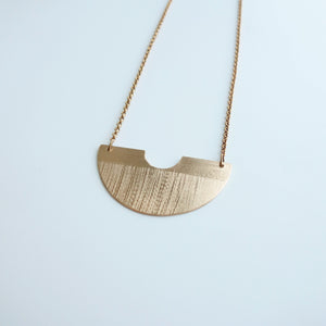Horizon half-circle brass necklace by Knuckle Kiss