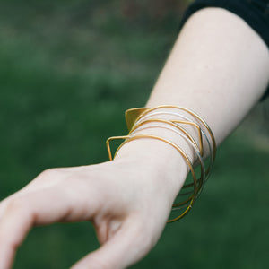 Knuckle Kiss brass triangle geometric bangle set