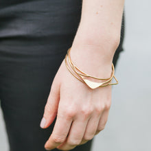 Brass triangle geometric bangle set by Knucklekiss