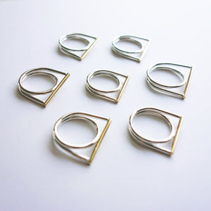 Two-tone brass and sterling Filament Rings by Knucklekiss