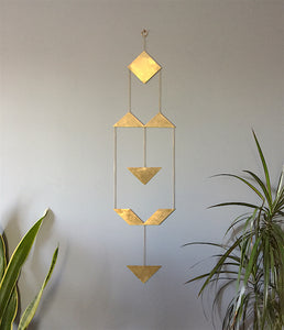 Brass triangle geometric wall hanging by Knuckle Kiss