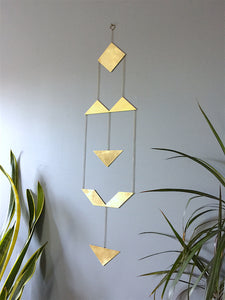 Geometric brass wall art by Knucklekiss