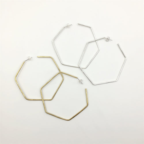 Large hexagon shape hoops in sterling and brass by Knuckle Kiss