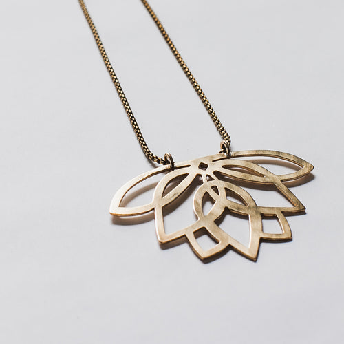 Large Lotus statement necklace handcut from thick brass by Knuckle Kiss