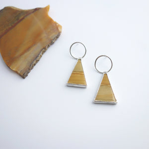 Apex Earrings in Owyhee Jasper by Knuckle Kiss, featuring natural patterns and a vivid yellow ochre color