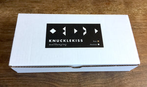Geometric brass wall hanging packaging by Knucklekiss