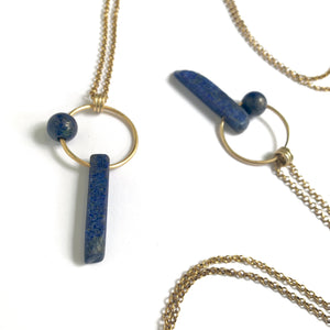 Long over the head brass and lapis necklaces by Knuckle Kiss