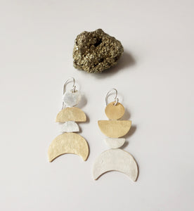 Asymetrical mixed metal moon phase earrings by Knucklekiss