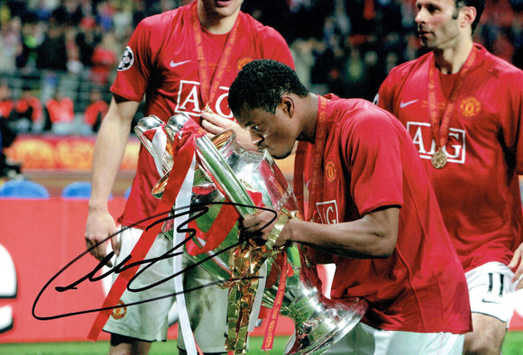 Patrice Evra - Manchester United - Treble - 12 x 8 Autographed Picture