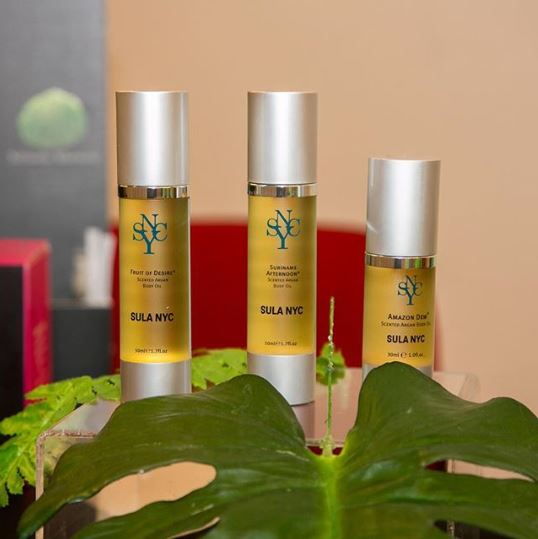 Three bottles of different sized argan oil