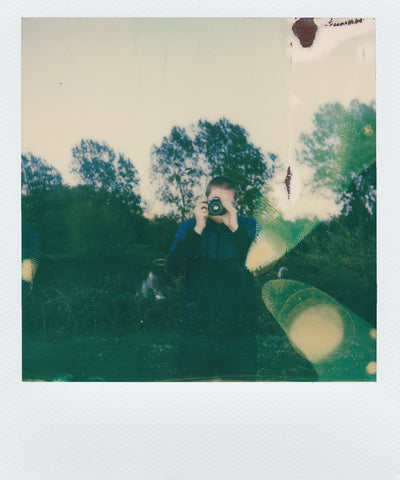 polaroid of person taking photos