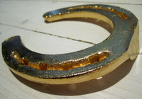 Horseshoe in gold colorFloby Överskottslager