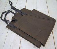 Gray brown cotton apron with chest pocketFloby Överskottslager