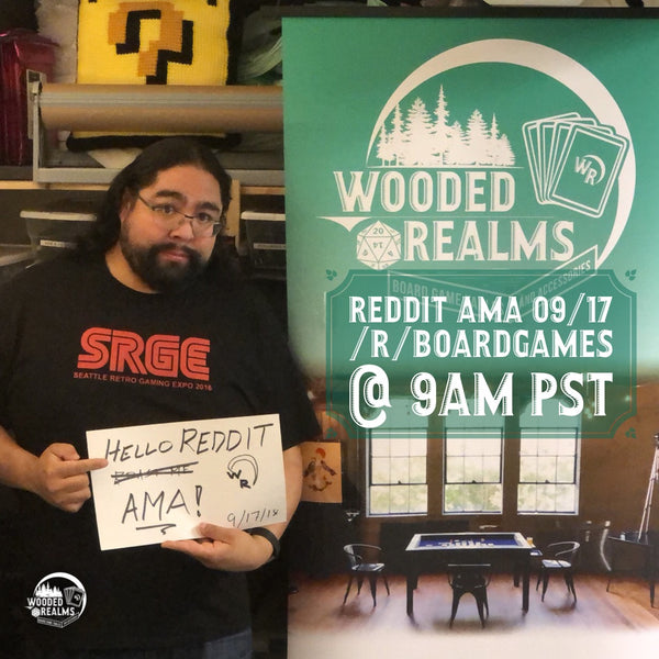 Nathan next to Wooded Realms Banner holding a Reddit AMA sign for proof
