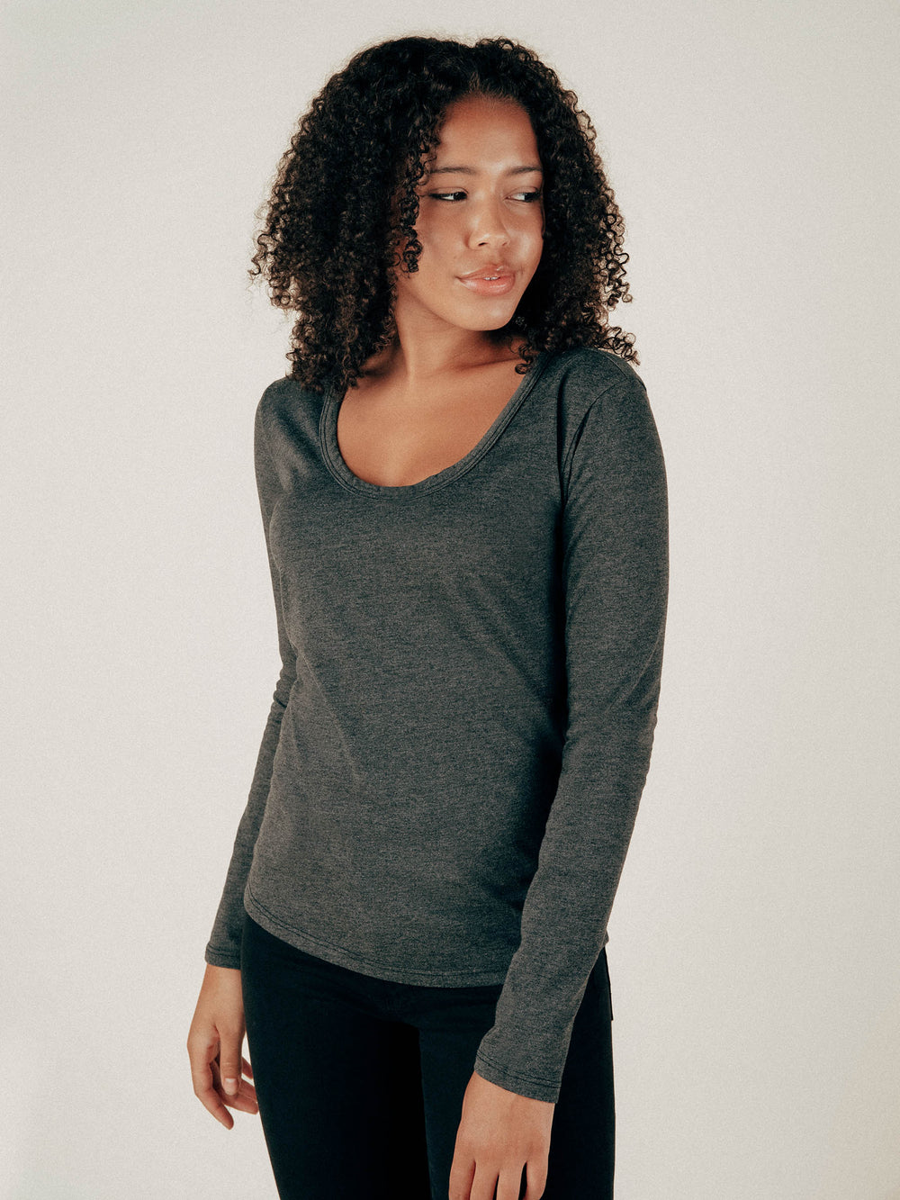 Faded Black Long Sleeve Scoop Neck Curved Hem Tee - Graceful District