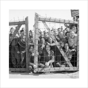POWs at Stalag 11B at Fallingbostel in Germany welcome their liberators, 16 April 1945.