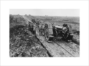 A 6-inch howitzer being manhauled through the mud near Pozieres during the Battle of the Somme in September 1916.