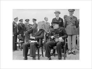 President Roosevelt and Winston Churchill seated on the quarterdeck of HMS PRINCE OF WALES for a Sunday service during the Atlantic Conference, 10 August 1941.