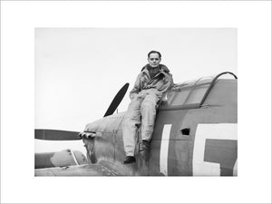 Squadron Leader Douglas Bader, CO of No. 242 Squadron, seated on his Hawker Hurricane at Duxford, September 1940.