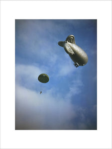 A paratrooper drops from a static balloon during training, 2 October 1942.
