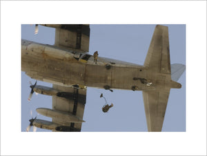 Paratroopers of 1st Battalion, The Parachute Regiment, jumping from an American C-130 Hercules in Kuwait, during training for operations in Iraq, 16 March 2003.