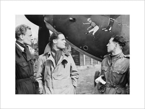 Squadron Leader Douglas Bader (centre) and fellow pilots of No. 242 Squadron, Flight Lieutenant Eric Ball and Pilot Officer Willie McKnight, admire the nose art on Bader's Hawker Hurricane at Duxford, October 1940.