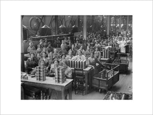 Women war workers range shell cases in the New Case Shop at the Royal Arsenal, Woolwich.