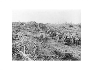 Horse-drawn ammunition limbers pass through the ruined village of Longueval, Somme, September 1916
