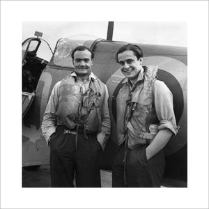 Two Battle of Britain fighter pilots, Flight Lieutenant  Brian Kingcome (left), commanding officer of No 92 Squadron RAF and his wingman, Flying Officer Geoffrey Wellum, next to a Spitfire at RAF Biggin Hill, Kent, 1941