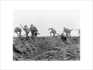 "Still from the British film ""The Battle of the Somme"". The image is part of a sequence introduced by a caption reading ""British Tommies rescuing a comrade under shell fire""."