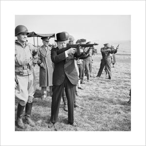 Winston Churchill fires a Thompson submachine gun alongside the Allied Supreme Commander, General Dwight D Eisenhower, during an inspection of US invasion forces, March 1944.
