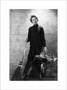 A Cecil Beaton portrait of a member of the Women's Royal Naval Service equipped for gardening duties.
