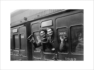 Soldiers onboard a leave train heading out from Victoria Station, London during the First World War.